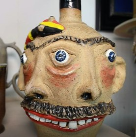 One of the strongest characteristics of Dark's work is the multitude of faces he creates, both as stand-alone sculptures and on pots, mugs and jugs. (Michael Tomberlin/Alabama NewsCenter)