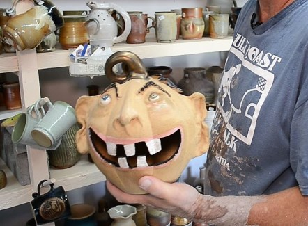 One of the strongest characteristics of Dark's work is the multitude of faces he creates, both as stand-alone sculptures and on pots, mugs and jugs. This is a jack-o-lantern. (Michael Tomberlin/Alabama NewsCenter)
