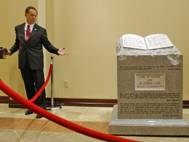 Alabama Supreme Court Chief Justice Roy Moore stirred controversy in 2001 by displaying a religious monument that included the Ten Commandments in the state's court building in Montgomery. In 2003, the Alabama Court of the Judiciary ordered the monument removed and terminated Moore's term in office. (From Encyclopedia of Alabama, courtesy of The Birmingham News)
