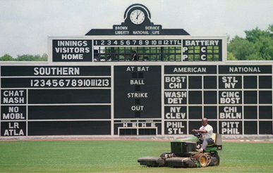 Anthony King mows the outfield grass at Rickwood Field in June 2001 in preparation for the Rickwood Classic. (From Encyclopedia of Alabama, courtesy of The Birmingham News, photograph by Bernard Troncale)