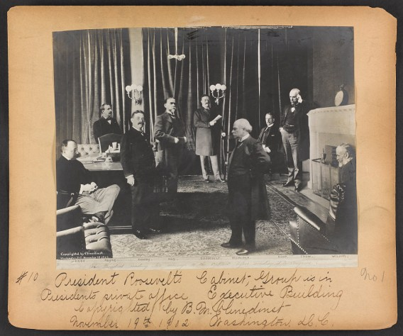 The president reading his message to the cabinet, before sending it to Congress, c. 1902. Left to right: George B. Cortelyou, Philander C. Knox, Henry C. Payne, William Henry Moody, John Hay, President Theodore Roosevelt, Ethan Allen Hitchcock, Elihu Root, Leslie Mortier Shaw, and James Wilson. (Photograph by Barnett McFee Clinedinst, Library of Congress Prints and Photographs Division)