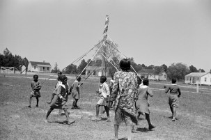 Rehearsing the maypole dance for May Day, health day exercises, 1939. (Photograph by Marion Post Wolcott, Library of Congress, Prints and Photographs Division)