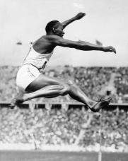 Jesse Owens doing the long jump at the 1936 Olympics in Berlin. (German Federal Archives, Wikipedia)
