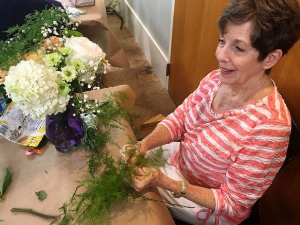 Three-year survivor Cathy Hogan loves taking part in flower arranging. (Donna Cope/Alabama NewsCenter)