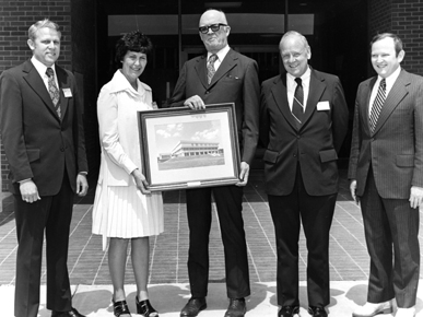 """This photo was taken in 1974 during the official opening ceremony of Auburn University at Montgomery. Pictured from the left: future Auburn University President Hanly Funderburk, unknown woman, Alabama Development Office director Robert """"Red"""" Bamberg, Auburn President Harry M. Philpott and Auburn University trustee Charles Smith. (From Encyclopedia of Alabama, courtesy of Auburn University Libraries)"""