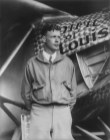 """Charles Lindbergh, with the """"Spirit of St. Louis"""" in background, 1927. (The photo was restored in 2013. Library of Congress, Prints and Photographs Division)"""
