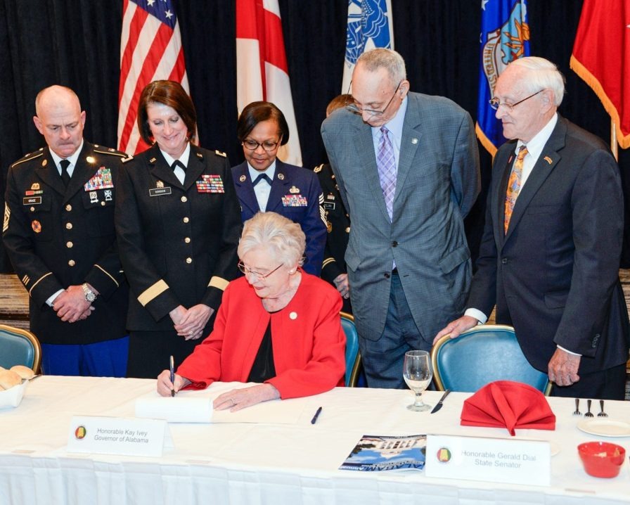 Alabama Gov. Kay Ivey signs Alabama House Bill 388 into law during the annual Governor's Outstanding Service Member Awards Luncheon at Maxwell Air Force Base, May 3, 2018. The Military Family Jobs Opportunity Act, enables military spouses with professional licenses from other states to transfer their qualifications to an Alabama license. (U.S. Air Force, photo by Airman Matthew Markivee)