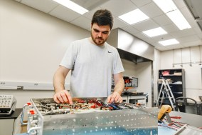 In a lab on the University of Alabama campus, graduate student Joshua Nunn works on the UA-developed radar that his research team used in Greenland. (University of Alabama)