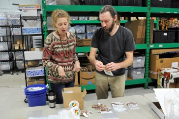 Jamie and Scott Laslo prepare an order in the back of the store. (Karim Shamsi-Basha/Alabama NewsCenter)
