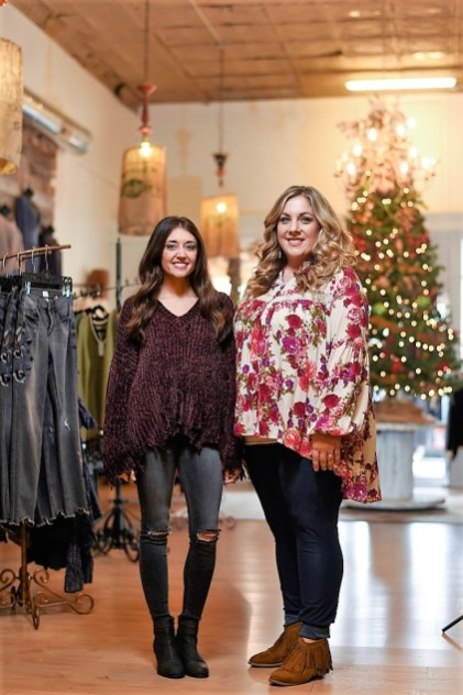 Courtney Thompson, left, and Meagan Richardson have created a retail destination in downtown Tuscumbia with Nellie Mae Boutique. (Brandon Robbins/Alabama Retailer)