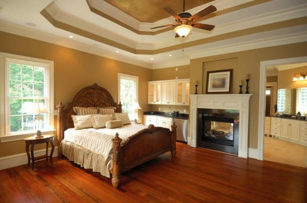 Fireplaces may be nice for ambiance, but they are not great for heating large rooms. A better idea is to turn a ceiling fan to winter mode (clockwise rotation) and push the warm air down from the ceiling. (Getty Images)