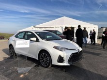 A Toyota Corolla sits outside the tent where officials are holding a groundbreaking ceremony for the Mazda Toyota manufacturing plant, which will make a new-generation Corolla. (Dennis Washington/Alabama NewsCenter)