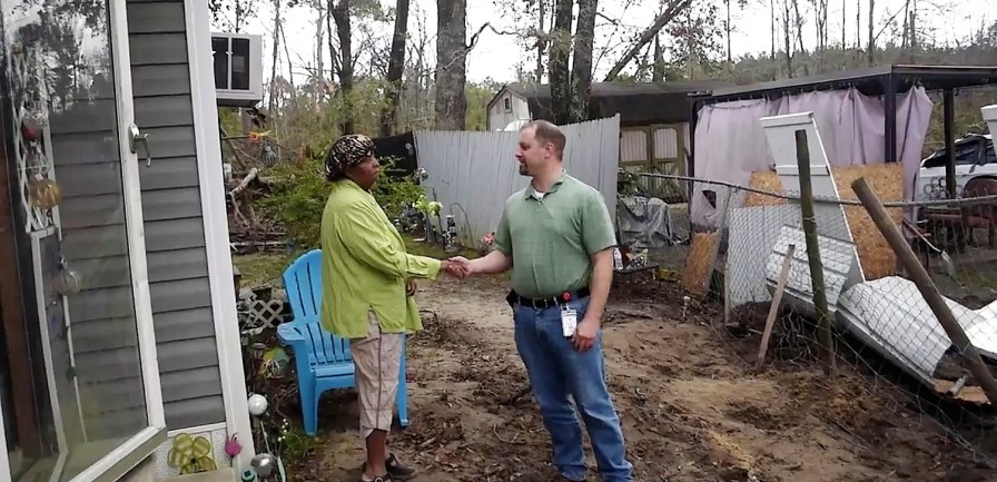 VOAD chairman Gary Griffin meets with a Gordon resident after Hurricane Michael tore up the Houston County town. (Karim Shamsi-Basha/Alabama NewsCenter)