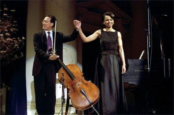 Cellist Yo-Yo Ma and National Security Advisor Dr. Condoleezza Rice take their bow after performing a duet to a Brahm's sonata at the presentation of awards by the National Endowment of the Arts and Humanities at Constitution Hall in Washington, DC, April 22, 2002. (Photograph by Paul Morse, Wikipedia)