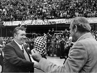 "Auburn University football coach Ralph ""Shug"" Jordan, left, and University of Alabama coach Paul ""Bear"" Bryant during the Iron Bowl at Birmingham's Legion Field in 1975, the year Jordan retired. (From Encyclopedia of Alabama, courtesy of The Birmingham News)"
