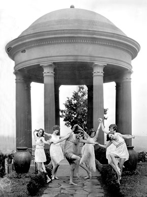 Young women perform a dance at the Temple of Sybil in Vestavia Hills, ca. 1930. The gazebo, which is a replica of the Temple of Sibyl in Tivoli, Italy, was built on the estate of former Birmingham mayor George Battey Ward in 1929. It was moved to its current location at the southern end of Vestavia Hills in 1976 and is owned by the Vestavia Garden Club. (From Encyclopedia of Alabama, courtesy of Birmingham Public Library Archives)