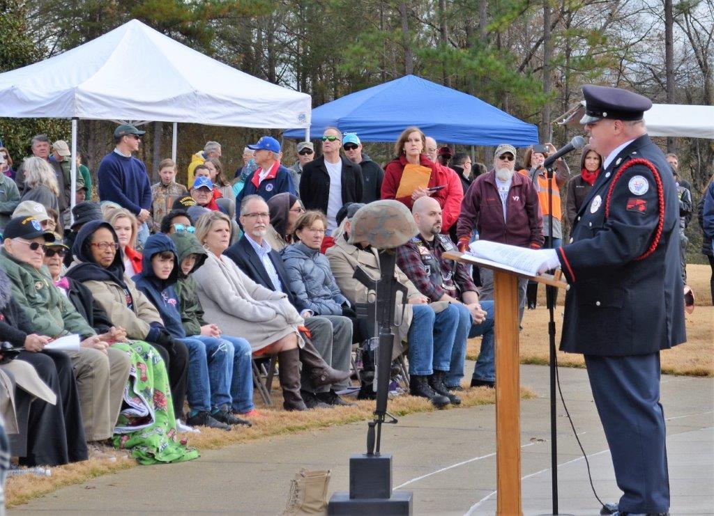 "Jim Quakenbush of Bugles Across America-Alabama sings ""America the Beautiful"" at the Wreaths Across America ceremony at the Alabama National Cemetery. (Michael Tomberlin / Alabama NewsCenter)"