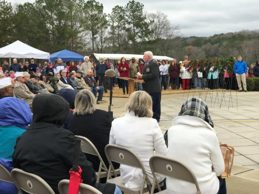 Medal of Honor recipient Capt. Gary Michael Rose delivers the keynote address at the Wreaths Across America ceremony at the Alabama National Cemetery. (Michael Tomberlin / Alabama NewsCenter)