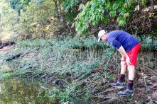 Alabama Power collaborated with state and national government biologists in a survey of threatened snail species in Alabama waterways. Shown is APC biologist Jason Carlee. (Justin Averette/Shorelines)