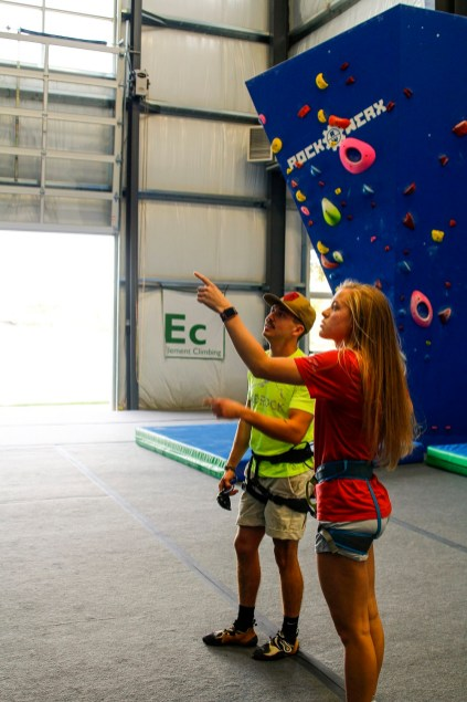 GadRock's Eric Johnson and Maggie Grizzard discuss a climb. (Justin Averette/Shorelines)