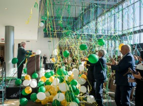 Balloons and streamers fall from the ceiling as Dr. Ray Watts, M.D. (president) speaks at the Campaign for UAB news conference in the Collat School of Business on Nov. 27, 2018 announcing over $1 billion in campaign contributions. (Adam Pope/UAB)