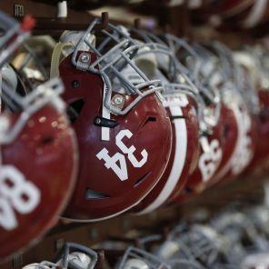Alabama runningback Damien Harris' (34) helmet joins other teammates. (Robert Sutton)