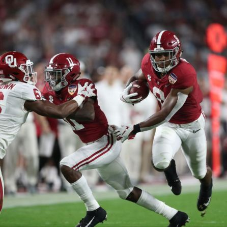 Alabama running back Josh Jacobs (8) explodes through the line. (Kent Gidley)