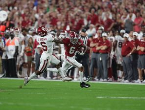 Alabama wide receiver DeVonta Smith (6) outruns defender. (Kent Gidley)