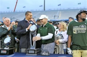 Head coach Bill Clark accepts the Conference USA (C-USA) football championship trophy after the Blazers defeated the Middle Tennessee State University Blue Raiders. (contributed)