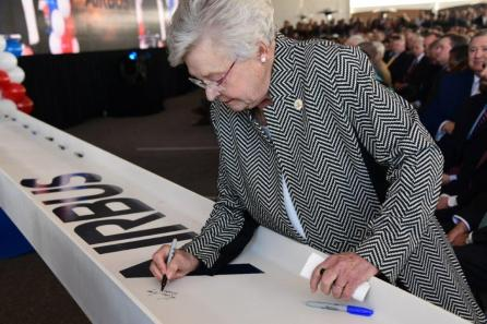 Alabama Gov. Kay Ivey signs a beam that will be used in the construction of the new A220 assembly plant in Mobile. (Airbus)