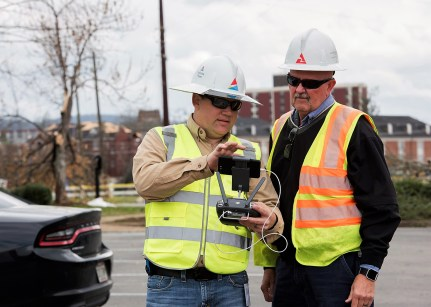 Alabama Power crew members monitor a drone conducting an aerial survey of storm damage following the March 2018 tornado in east Alabama. (file)