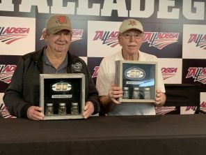 Talladega Superspeedway presented legendary drivers Donnie Allison (left) and Red Farmer (right) with a display case which includes asphalt from the track. (Dennis Washington)
