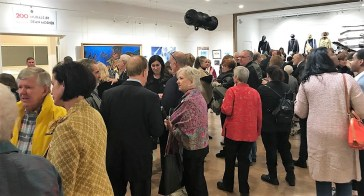 A crowd attends the Dean Mosher historical mural exhibit at the Eastern Shore Art Center in Fairhope. (Dan Bynum/Alabama NewsCenter)