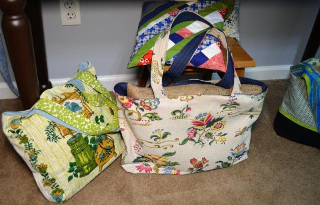 Thimbletreestudio uses everything from old pants to drapery to put together one-of-a-kind totes. (Michael Tomberlin / Alabama NewsCenter)