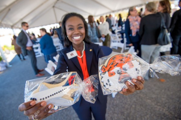 A representative of Auburn University shows off the partnership between Delta Air Lines and Auburn University in cookies. (Auburn)