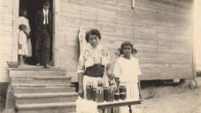 African-American woman and young girl with jars of preserves in Madison County. The women are probably members of a local homemakers' club, c. 1915-17. (Alabama Department of Archives and History)