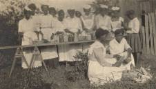 African-American women shucking corn and making preserves in Conecuh County. The women are probably members of a local homemakers' club, c. 1915-17. (Alabama Department of Archives and History)