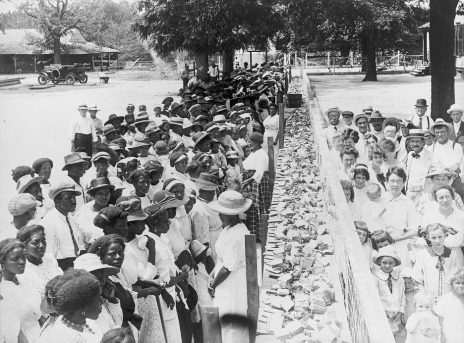 F.M. Gay's annual barbecue given on his plantation every year, with a long counter covered with slices of bread separating crowds of African-Americans and whites, c. 1930 to 1941. (Library of Congress, Prints and Photographs Division)
