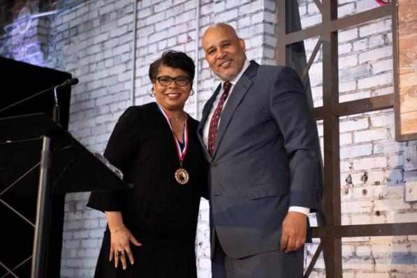 Sam Martin, executive director of the Foundation for Progress in Journalism, right, presents April Ryan with the FPJ Medal of Honor at the Power of Culture and Contribution luncheon at The Theodore in the Lakeview neighborhood in downtown Birmingham. (Christopher Jones / Alabama NewsCenter)