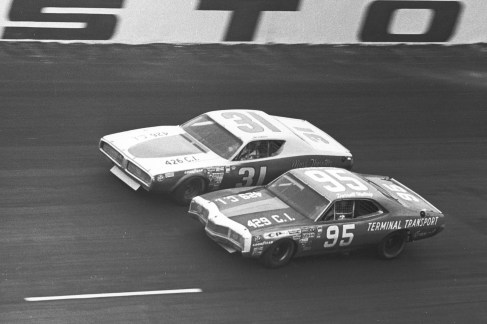 Darrell Waltrip (No. 95) races side-by-side with Jim Vandiver (No. 31) during the Winston 500 at Alabama International Motor Speedway. An oil leak dropped Waltrip to a 31st-place finish, while Vandiver took the checkered flag in eighth position. (Photo by ISC Images & Archives via Getty Images)