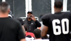 Coach Tim Lewis talks to his players as the Birmingham Iron's season opener against the Memphis Express draws near. (Solomon Crenshaw Jr./Alabama NewsCenter)