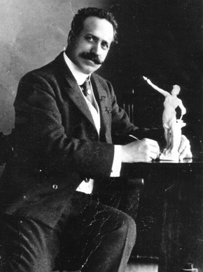 Giuseppe Moretti poses here with a model of his sculpture of Vulcan, commissioned in 1903 by the Commercial Club of Birmingham to represent Alabama at the 1904 World's Fair in St. Louis, Missouri. (From Encyclopedia of Alabama, Birmingham Public Library Archives)
