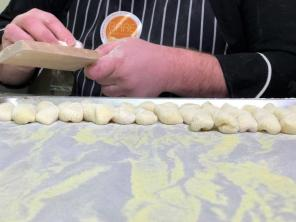 Chefs at Bare Naked Noodles prepare fresh gnocchi. (Michael Tomberlin / Alabama NewsCenter)