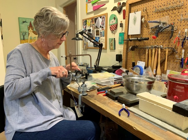 Anne Moore devotes a great amount of time to design and develop each piece of handmade jewelry. (Brittany Faush / Alabama NewsCenter)