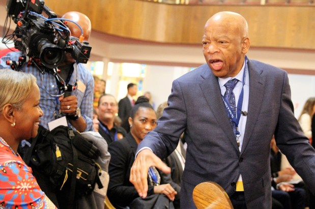 U.S. Rep. John Lewis greets people at 16th Street Baptist Church in Birmingham. (Justin Averette/Alabama NewsCenter)