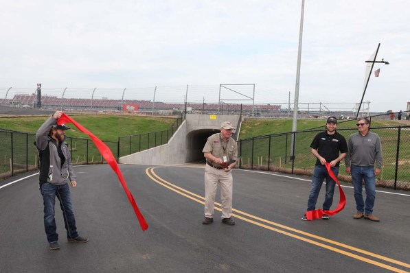 "NASCAR drivers Jeffrey Earnhardt (left) and Chase Briscoe (second from right) joined Talladega Superspeedway Chairman Grant Lynch (center), and Lance Taylor (far right) from Taylor Corporation, who spearheaded the tunnel construction efforts, in the ribbon-cutting ceremony on Wednesday as part of the ""official"" Grand Opening for fans to enter the track's iconic infield. (contributed)"