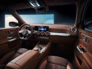 "The seats, fittings and door panels of the Concept GLB are partially lined in nappa and nubuk leather, the predominant color tone being ""chestnut brown"". The wood trim elements on the dashboard and center console are open-pore walnut. The walnut panels have a chiselled honeycomb pattern that fades out towards the edges. The basic architecture of the dashboard corresponds to that of the B-Class, with a widescreen cockpit facing the driver and functions and displays controlled via the Mercedes-Benz User Experience – MBUX. (Mercedes-Benz)"