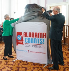 Alabama Gov. Kay Ivey and ADECA Director Kenneth Boswell unveil the Alabama Counts logo and website. (Hal Yeager/Governor's Office)