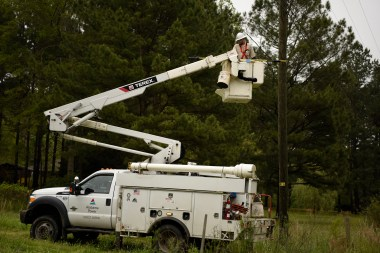An Alabama Power lineman works to restore electrical service on Friday in the wake of Thursday night's storm. (Phil Free/Alabama NewsCenter)
