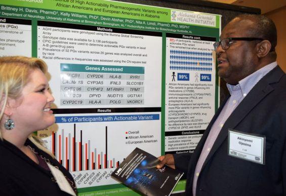 UAB postgraduate student Brittney Davis talks with Akinyemi Ojesina. (Donna Cope/Alabama NewsCenter)